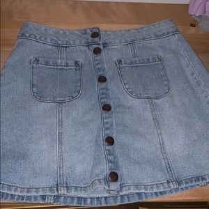 button up light wash jean skirt.